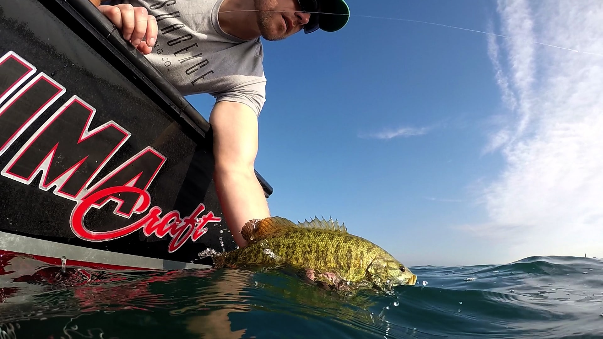 Nate with a stud Smallmouth Bass on the Big Water